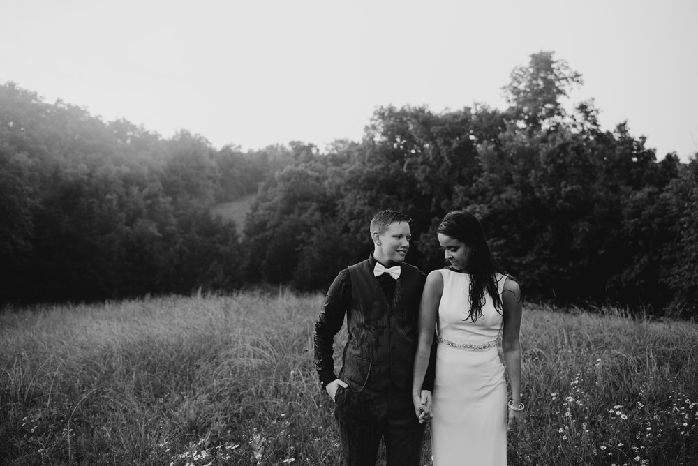 black and white photo of married women holding hands in Kentucky field