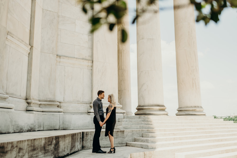 engagement session at Thomas Jefferson Memorial with columns in background