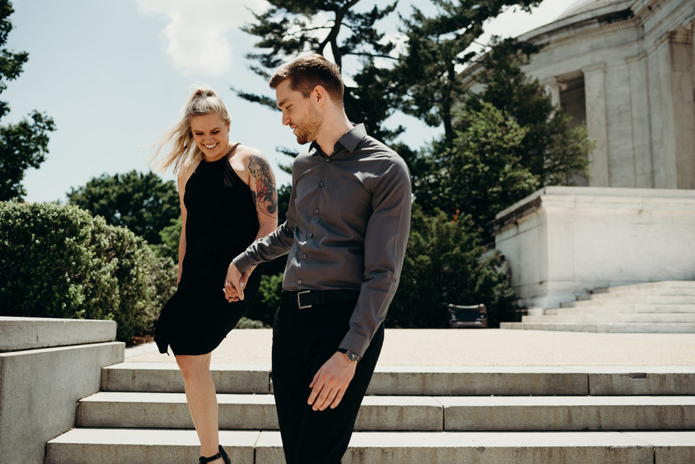 engagement session on steps of Thomas Jefferson Memorial with trees in background