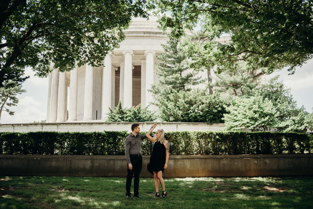 engagement photo with smiling couple among trees at Thomas Jefferson Memorial