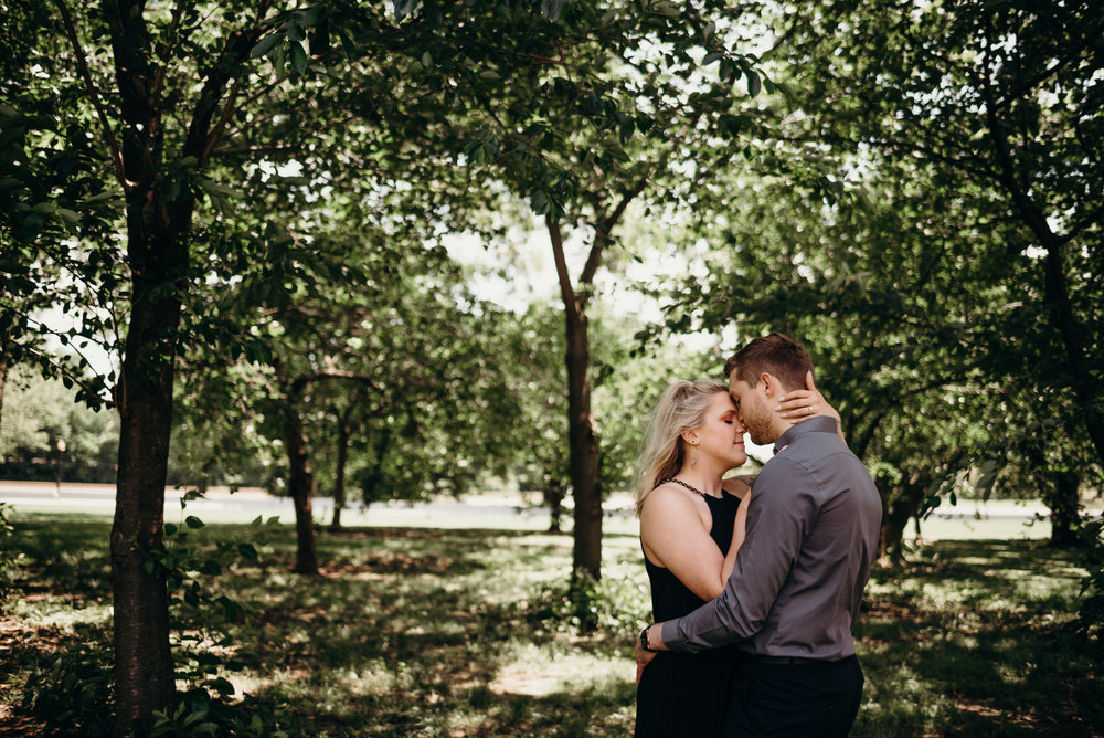 engagement session embracing among trees at Thomas Jefferson Memorial