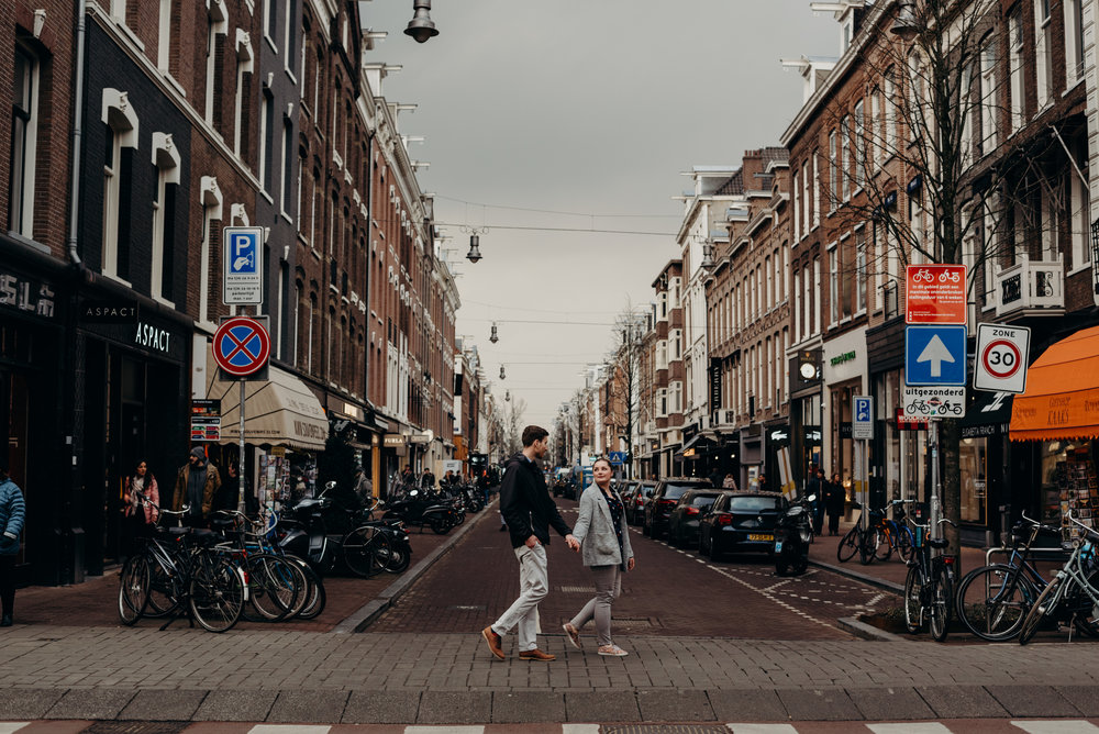 newly married couple walking down streets of Amsterdam
