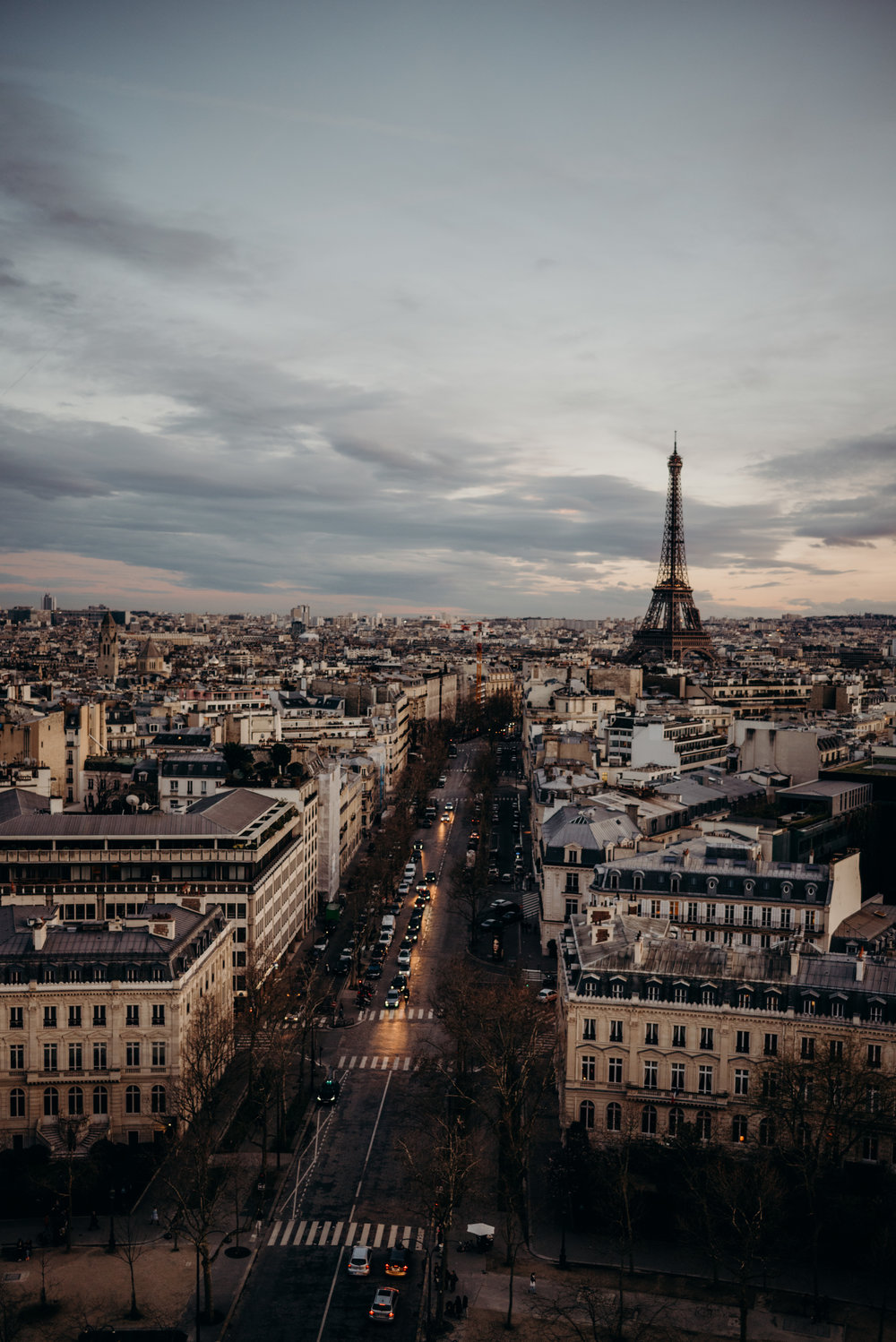 Paris streets in the evening with the Eiffel Tower in background